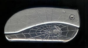 www.yourknifesucks.com Engraved Web With Engraved Spider Centered